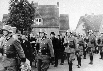 German Nazis round up Dutch Jews for deportation to Poland's death camps. WWII. Photo undated.