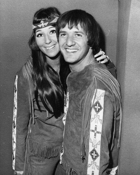 "Cher's father was of Armenian heritage and her mother had some Cherokee blood. She played up her Native American heritage by wearing traditional costumes with beadwork and fringe and singing songs such as ""Half-Breed"" and ""Gypsies, Tramps, and Thieves."" Note the unisex theme in their outfits. ca. 1965."