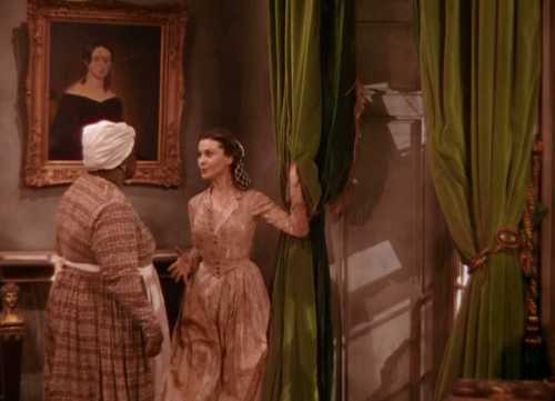 "In ""Gone With the Wind,"" Scarlett O'Hara prepares to tear down the curtains to make a dress."