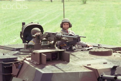 Former Massachusetts governor Mike Dukakis dons a helmet and drives a tank for a photo op. Sept. 13, 1988.