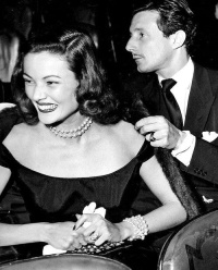 Gene Tierney smiles broadly while husband, Oleg Cassini, looks away. ca. 1945