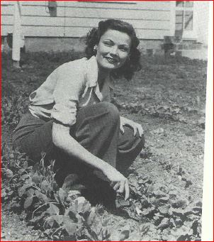 "Gene T tends her own ""victory garden,"" in Fort Riley, Kansas, where her husband is stationed in the army.  She is pregnant with her first child, Daria. 1943. (photo courtesy Lou and Mary Jo Mari)"
