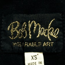 The tag from Mandy Denson's vintage Bob Mackie shirt.