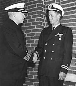 John F. Kennedy receives the Navy and Marine Corps Medal for his courage in the PT-109 incident. 1943