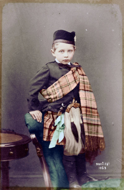 "Kaiser Wilhelm II, age 4, visits his beloved ""Granny"" (Queen Victoria) at her Scottish estate at Balmoral. Someone has costumed him carefully so as not to reveal his lame left arm. 1863."