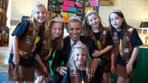 President Barack Obama dons a tiara with the Girl Scouts. May 2014