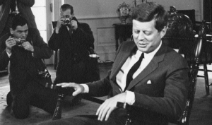 American photographer Stanley Tretick (l.) photographs President John F. Kennedy in the Oval Office, 1962. (Abbie Rowe, JFK Library and Museum)