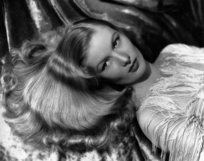 Veronica Lake liked to say that she didn't do cheesecake shots like Betty Grable but, rather, used her hair for sex appeal. Photo undated, ca. 1942