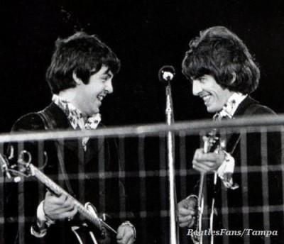 (l. to r.) Paul McCartney and George Harrison perform at Candlestick Park, San Francisco, in August of 1966. This was their final official performance. They were burned out and complained that the fans were so loud they couldn't hear themselves playing the music.