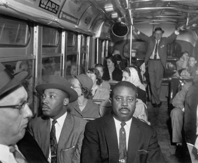 wo black ministers who were active in the long boycott of segregated buses in Montgomery, Alabama were among the first to ride after a Supreme Court integration order went into effect on December 21, 1956. At left, front seat, is the Rev. Ralph Abernathy, while at left in the second seat is the Rev. Dr. Martin Luther King Jr. Beside King is white minister, Rev. Glenn Smiley of New York, who said he was in Montgomery as an observer.