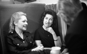 President Lyndon B. Johnson (back to camera at right) speaks with Mathilde Krim and Lady Bird Johnson First Lady of the United States Lady Bird Johnson and Mathilde Krim are on board a helicopter en route from Krim Ranch to LBJ Ranch, near Stonewall, Texas. President Johnson has his back to photographer. November 7, 1966. Photo by Mike Geissinger. LBJ Presidential Library. 3837-37