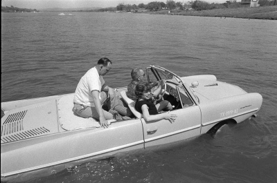 President Lyndon B. Johnson in the Amphicar with Eunice Kennedy Shriver and Paul Glynn. April 10, 1965. Photo by Yoichi Okamoto. LBJ Presidential Library A263-8